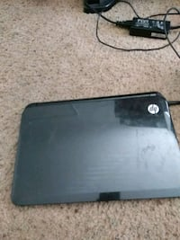 black HP laptop with AC adapter 2230 mi