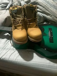 pair of brown leather work boots 415 mi