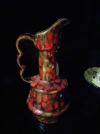 brown and red stoneware pitcher Biloxi, 39531