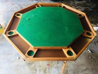 Green and brown wooden poker table