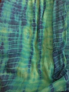green and blue tie-dye textile