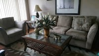 brown wooden framed glass top coffee table Baltimore, 21215