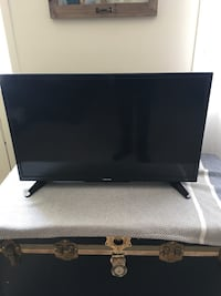 black flat screen TV with remote Edmonton, T6E 4R6