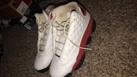 Pair of white-and-red air jordan 13 Houston, 77090