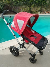 baby's red and black stroller