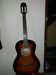 brown and black classical acoustic guitar