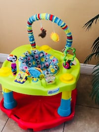 baby's yellow and red activity saucer