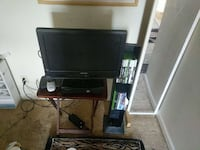 15 inch flat screen tv xbox 360 control and games.