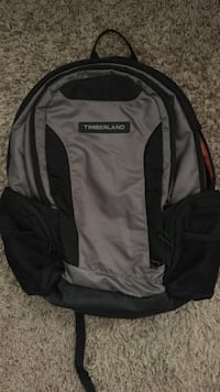 black and gray Timberland backpack