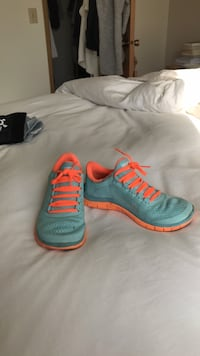 pair of gray-and-orange Nike running shoes Seattle, 98115