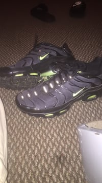 pair of black-and-green Nike basketball shoes Little Rock, 72227