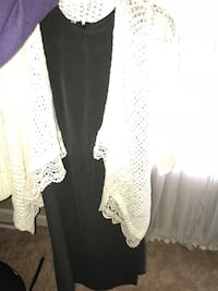 Women's white knitted cardigan and black scoop-neck dress