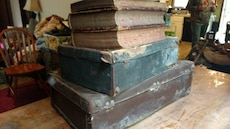 Very old dictionaries and suit cases
