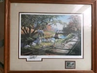 body of water painting with brown wooden frame