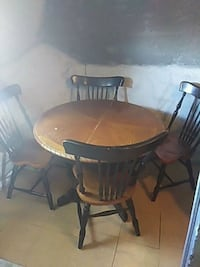 round brown wooden table with four chairs dining set Chicago, 60602