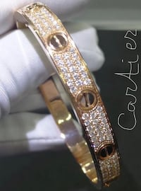 gold-colored clear gemstone bangle