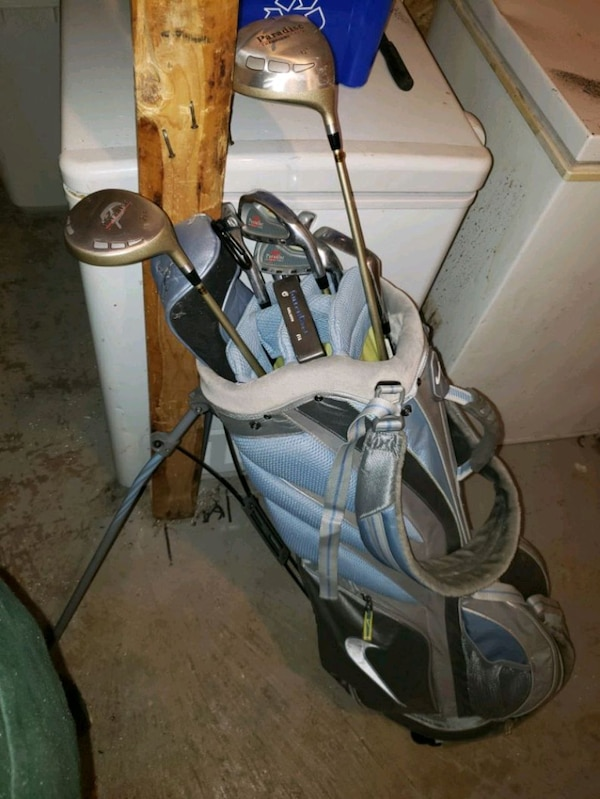 Women's gold bag with some clubs and more