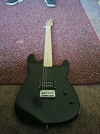 black electric guitar with amp