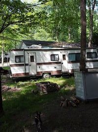 white and brown RV trailer Andover, 44003