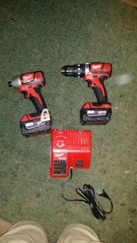 two red-and-black Milwaukee cordless power tools
