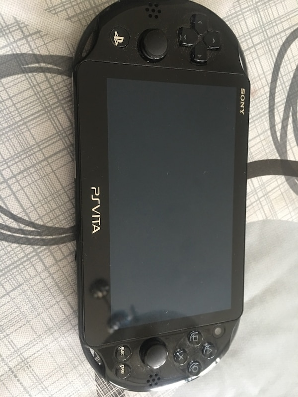 PSVita - almost new- hardly used- paid $220. one game paid $50 uncharted.