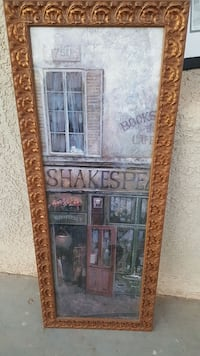 Shakespear building painting with brown wooden fra San Luis, 85349