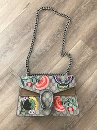 monogrammed gray and multicolored floral Gucci crossbody bag