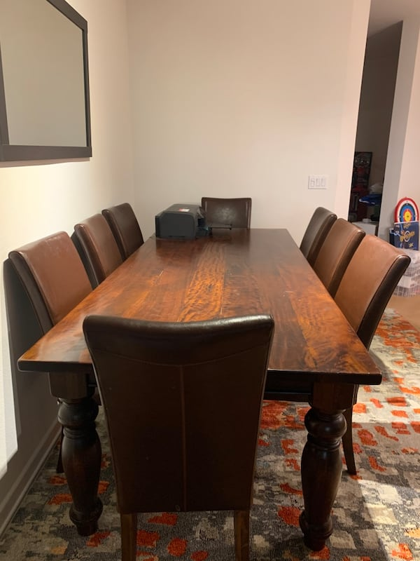 Beautiful mango dining table + 8 leather chairs 19f73e1d-b55d-4f08-84ff-bd43d03e1182