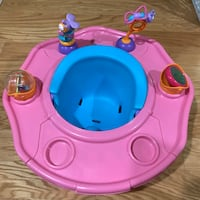 baby's blue floor seat and pink activity tray