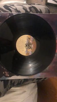 Kiss LP with rare Love Gun with intact gun punch out