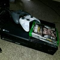 Xbox One console with controller and game cases Reading, 19601
