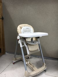 White and beige high chair