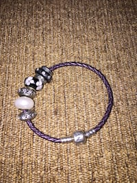 Real Pandora leather bracelet including the charms on the pic. (Not pandora charms) Calgary, T3E 6L9