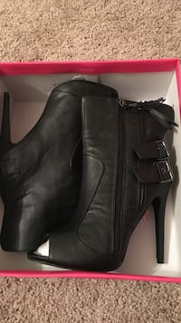 pair of black leather 2-buckle heeled booties with pink box Clarksville, 37042