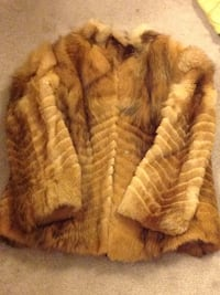 brown and white fur coat 556 km