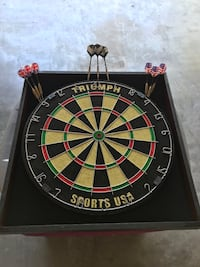 black, beige, and green dartboard with pins Corpus Christi, 78413