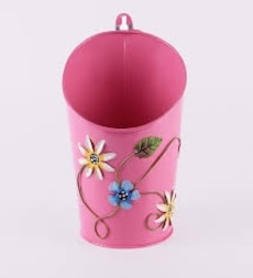 pink, white and teal floral trash can
