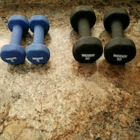 pair of blue and black fixed dumbbells
