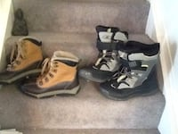 two pairs of black and brown mid-calf snow boots