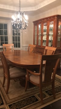 Oval brown wooden dining table set with china cabinet Reston, 20190