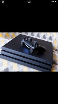 black Sony PS4 console with controller 918 mi