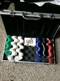 Texas Holdem case and chips plus playing cards. Text to  [TL_HIDDEN] .