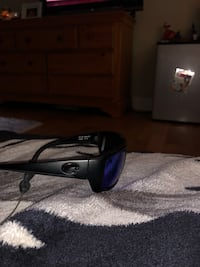 black and blue Oakley sunglasses