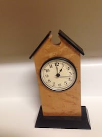 brown pendulum clock 13 km