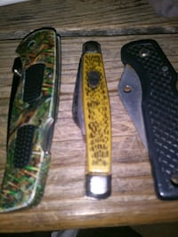 two green and black folding knives Lansing, 48912