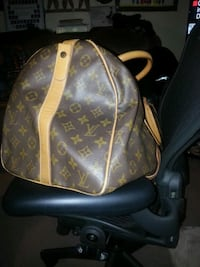 brown Louis Vuitton leather backpack Toronto, M6E 4V2