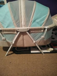 baby's white and blue bassinet 66 km