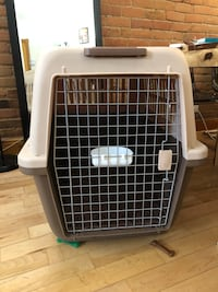 Dog cage one time used like new Large plastic cage for transportation.
