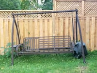 patio swing that lays flat.  comes with cushions.  Orangeville, L9W