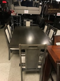 Rectangular dark grey wooden table with six chairs dining set